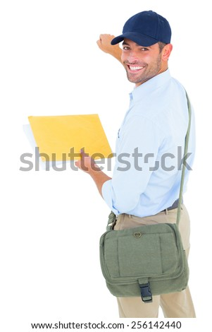 Portrait of smiling postman with letter knocking on white background - stock photo