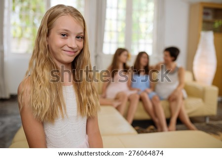 Portrait of smiling pretty preteen girl at home - stock photo