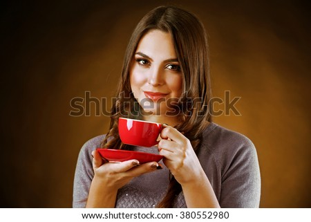 Portrait of smiling pretty woman with cup of coffee - stock photo