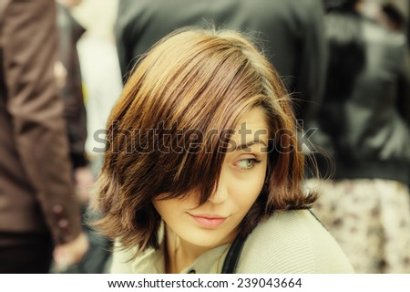 Portrait of smiling pretty young woman (shallow dof)  - stock photo