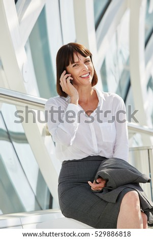 Portrait of smiling professional business woman talking on smart phone
