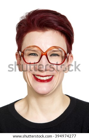 portrait of smiling red-haired woman with big glasses