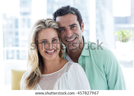 Portrait of smiling romantic couple at home