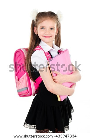 Portrait of smiling schoolgirl in uniform with backpack and books isolated on a white background