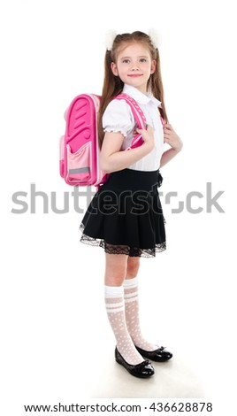 Portrait of smiling schoolgirl in uniform with backpack isolated on a white background - stock photo