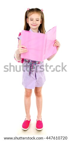 Portrait of smiling schoolgirl reading the book with backpack isolated on a white background - stock photo