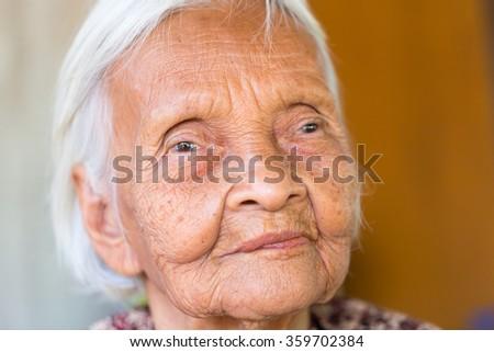 portrait of smiling senior asian woman - stock photo