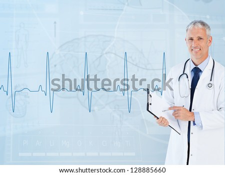 Portrait of smiling senior cardiologist using a clipboard - stock photo