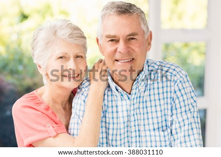 Portrait of smiling senior couple at home - stock photo