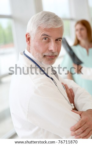 Portrait of smiling senior doctor