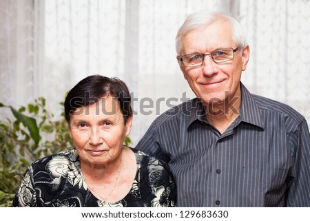 Portrait of smiling senior man and woman. - stock photo