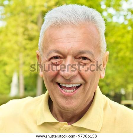 Portrait of smiling senior man outdoors. - stock photo