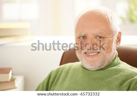 Portrait of smiling senior man with white hair, looking at camera.?