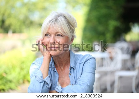 Portrait of smiling senior woman - stock photo