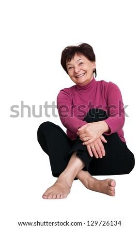 Portrait of smiling senior woman - isolated on white - stock photo