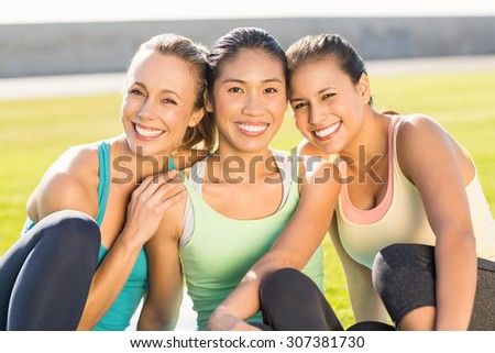 Portrait of smiling sporty women looking at camera in parkland