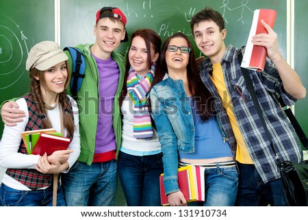Portrait of  smiling students together - stock photo