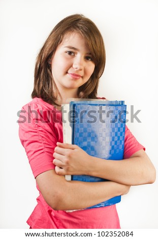 Portrait of smiling teen girl holds books isolated on white background
