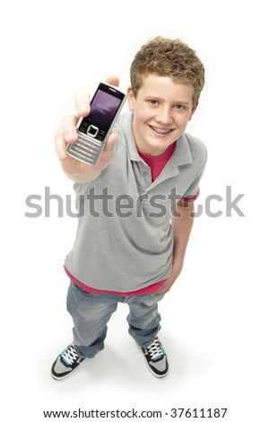 Portrait of Smiling Teenage Boy Holding Mobile Phone - stock photo