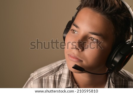 Portrait of Smiling Teenage Boy Listening Music with headphone - stock photo