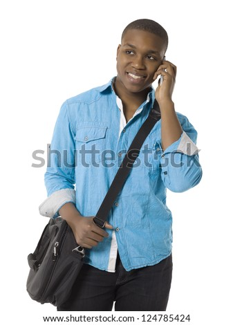 Portrait of smiling teenage student talking on the phone against white background