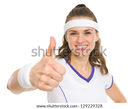 Portrait of smiling tennis player showing thumbs up