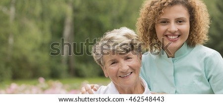 Portrait of smiling two women-senior and young