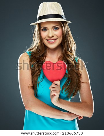 portrait of smiling woman hold red heart . model with long hair - stock photo
