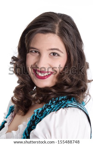 Portrait of smiling woman in dirndl