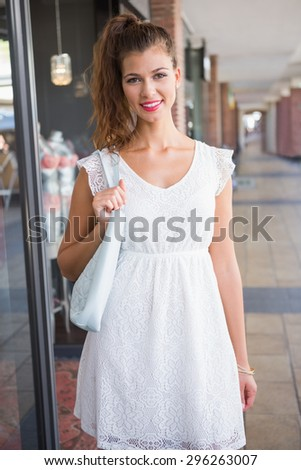 Portrait of smiling woman looking at camera at the shopping mall