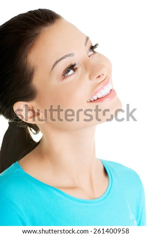 Portrait of smiling woman looking up. - stock photo