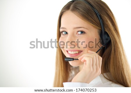 Portrait of smiling woman phone operator with headset