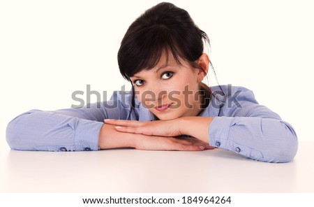 Portrait of smiling woman resting her chin on hands, white background. - stock photo