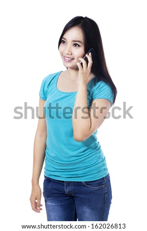 Portrait of smiling woman talking on phone, isolated on white background