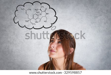 Portrait of smiling woman thinking of science in bubble