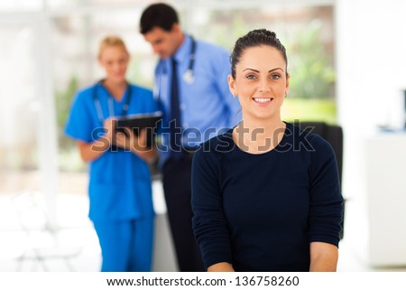 portrait of smiling woman waiting for checkup in doctor's office
