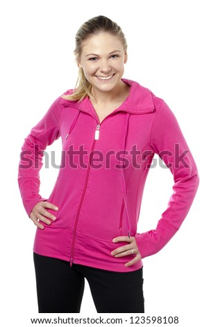 Portrait of smiling woman while arms on her waist against white background - stock photo