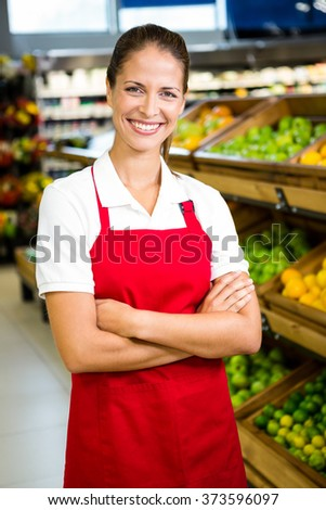 Portrait of smiling worker in grocery store