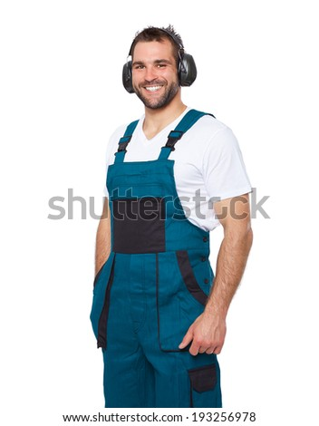 Portrait of smiling worker in his uniform with protective earphones isolated on white background  - stock photo