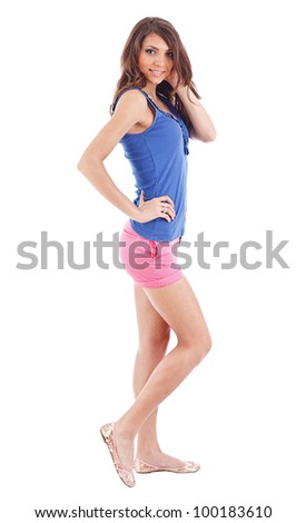 Portrait of smiling young beautiful woman in shorts at full heigh - stock photo