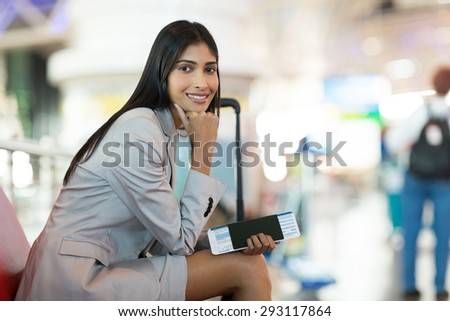 portrait of smiling young business woman waiting at airport