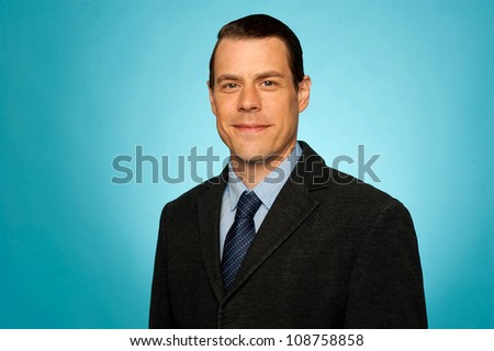 Portrait of smiling young businessman isolated over gradient background - stock photo