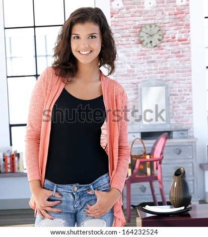 Portrait of smiling young caucasian woman at home. - stock photo