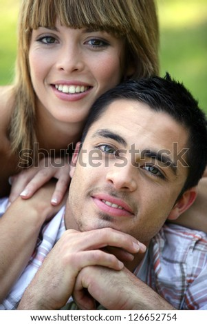portrait of smiling young couple - stock photo