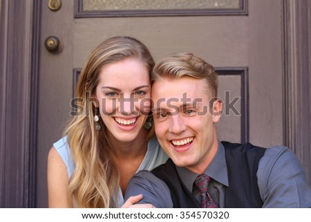 Portrait of smiling young couple at home - stock photo