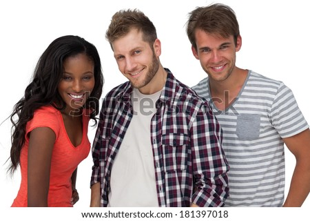 Portrait of smiling young friends standing over white background