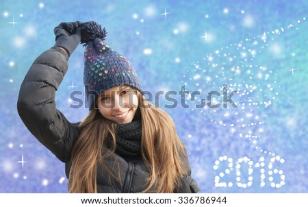 Portrait of smiling young girl in cold weather dressed warm hat - stock photo