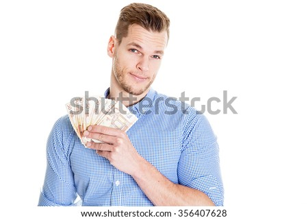 Portrait of smiling young man holding Euro paper currency isolated over white background - stock photo