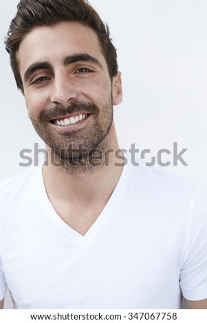 Portrait of smiling young man in white