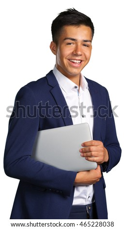 Portrait of smiling young man with laptop